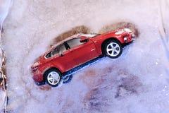 Christmas decor, car inside ice. Christmas decor, red car inside ice Royalty Free Stock Image