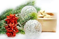 Christmas decor. red ribbon, golden gift, balls Stock Photos