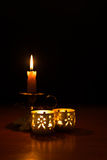 Christmas decor. Set of Christmas candle on a wood table with flame on Royalty Free Stock Photo
