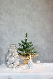 Christmas decor with silver balls and candle Stock Images