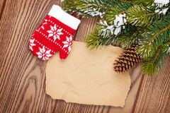 Christmas decor with snow fir tree background and paper Stock Image