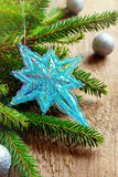 Christmas decor with star and fir Stock Photo