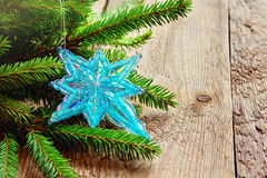 Christmas decor with star and fir Stock Photos