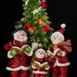 Christmas decor. Three snowman in santa claus dress with tree Royalty Free Stock Photography