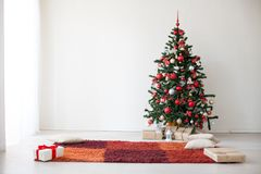 Christmas Decor white room new year tree gifts. 2018 2019 Royalty Free Stock Image
