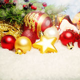Christmas Decor on White Snow. Bright Xmas Card Background Stock Images