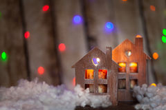Christmas decor: wood houses. With candles Stock Photos