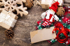 Christmas decor on the wooden background. Royalty Free Stock Images