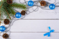 Christmas decor on a wooden background, top view. Spruce branches, pine cones and Christmas balls Stock Photography