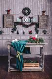 Christmas decor in a wooden house. The shelf is decorated with a garland and fir branches. Wooden table with decor. Christmas decor in a wooden house. The shelf Stock Photo