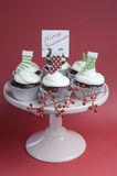 Christmas decorated chocolate red velvet cupcakes - vertical. Royalty Free Stock Image