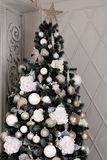Christmas decorated Christmas tree.  New Year`s toys, balls, flowers, bows. Christmas decorated Christmas tree. New Year`s toys, balls, flowers and bows Stock Photo