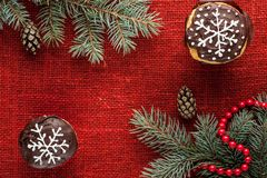 Christmas decorated cupcakes at red burlap background top view Stock Images