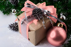 Christmas decorated gift box with pink ribbon Stock Images