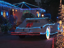 Christmas decorated house and dream car stock photography