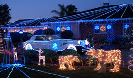 Christmas decorated house and dream luxury car. Christmas decorated house and Phantom Zimmer luxury car, a U.S. neo-classic automaker that used to build just a stock photography