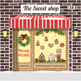 Christmas decorated and illuminated sweet shop Stock Photography