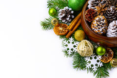 Christmas decorated pine cones in wooden bowl with fir branches Stock Images