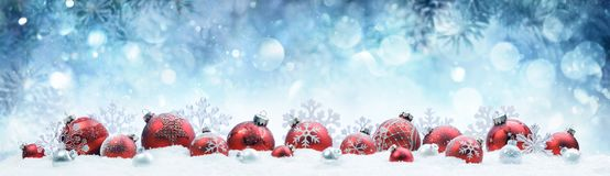Christmas - Decorated Red Balls And Snowflakes. On Snow stock images