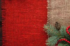 Christmas decorated red burlap tablecloth background top view. Christmas decorated red and brown burlap tablecloth background top view Royalty Free Stock Photography