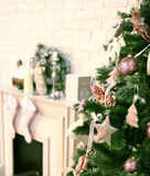 Christmas decorated tree with fireplace and santa socks. Christmas decorated tree fireplace and santa socks stock images