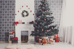 Christmas decorated tree in modern interior, holiday concept Royalty Free Stock Images
