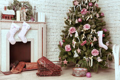 Christmas decorated tree with presents and deer Stock Photo