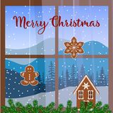 Christmas decorated window, with garland, gingerbread man.. Christmas decorated window, with fir garland, gingerbread man, house. view of Winter landscape with Stock Photos