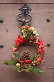 Christmas decorated wreath in an antique wooden door. France Royalty Free Stock Images