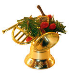 Christmas decorating. Consisting of a handbell, trumpet, branches and berries. It is isolated on a white background Royalty Free Stock Photo