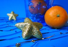 Christmas decorating. Gold glitter star Stock Photo
