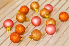 Christmas decorating balls. Small christmas decorating balls in golden copper and pink colors Stock Image