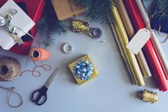 Christmas decorating present box on gray wooden background. New Year and Christmas decorations concept. Copy space. Toned royalty free stock photography