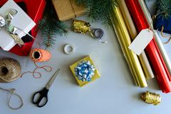 Christmas decorating present box on gray wooden background. New Year and Christmas decorations concept. Copy space royalty free stock image