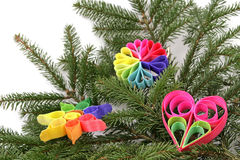 Christmas decoration. Twig of the spruce with color decorations Stock Image