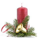 Christmas decoration. Red candle with the twig of the spruce and bell Stock Photos