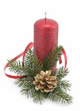 Christmas decoration. Red candle with the twig of the spruce and the cone Stock Photo