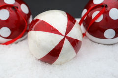 Christmas Decoration. Red and White balls on snow background Royalty Free Stock Photo