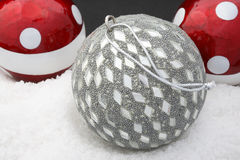 Christmas Decoration. Red, white and silver balls on snow background Royalty Free Stock Photo