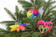 Christmas decoration. Twig of the spruce with color decorations Royalty Free Stock Images