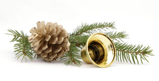 Christmas decoration. Twig of the spruce decorated with cones Stock Photos