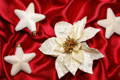Christmas decoration. On red sateen with flower and stars royalty free stock images