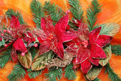 Christmas decoration. On golden sateen with flowers stock photography