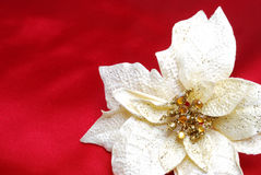 Christmas decoration. On red sateen with white flower royalty free stock images