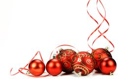 Christmas decoration. Red christmas balls with ribbons on the white background Stock Photos