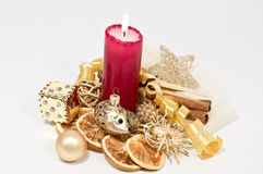 Christmas decoration. With burning red candle Stock Image