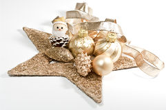 Christmas decoration. In gold on white Royalty Free Stock Photo