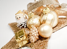 Christmas decoration. In gold on white Royalty Free Stock Photography