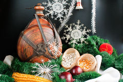 Christmas decoration. With snowflakes, small keg, garland, onion, corn and haricot beans isolated on black background Royalty Free Stock Photography