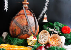 Christmas decoration. With snowflakes, small keg, garland, onion, corn and haricot beans isolated on black background Stock Photography